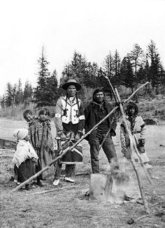 John Hunter (in beaded vest), George Maclean and family prepare a meal on the Stoney Reserve
