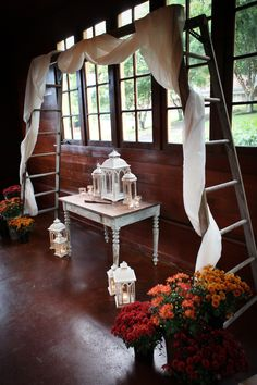 Real Wedding: Garden Party Themed Wedding at Jenkins Estate // ladder altar with rustic table and lanterns