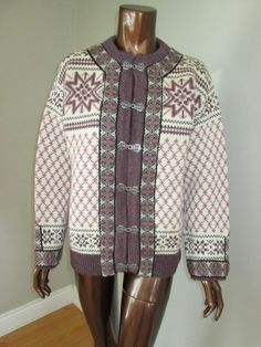 """Cream with pink and purple pattern. Embroidered trim and metal clasp buttons down the front (likely pewter). Approximate measurements, taken flat with cardi buttoned up: Armpit to armpit:21"""", Shoulders, seam to seam across the front: 19"""", Sleeves, from cuff to shoulder seam: 21"""" and 30"""" from cuff to middle of back of neck, Top of shoulder to hem: 26"""".   eBay!"""