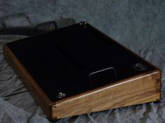 Helwig custom pedal board. Comes with a lid/cover/case thing. Made of your choice of beautiful hard woods. Want.