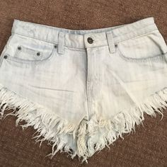 LF CarMar super frayed denim cut-off shorts! These shorts are practically brand new- supposed to look worn and distressed in color. Run small, more like a size 27 fit! They are a dolphin cut- go shorter on sides. LF Shorts Jean Shorts