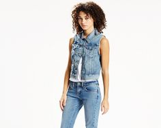 An instant dash of denim. This vest has the iconic fit of our Authentic Trucker and adds that smart, rugged Levi's look to your outfit. Customized for a woman's figure with a tailored fit and cropped look.