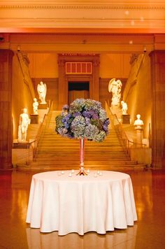 Soft lighting and an arrangement of purple hydrangeas greeted   guests in the main hall.