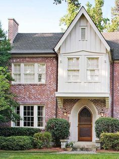 Identified by their steeply pitched rooflines and decorative half-timbering, Tudor-style homes range from elaborate mansions to modest suburban residences. See pictures of Tudor homes and get ideas for your own home here. Exterior Colors, Exterior Design, Exterior Paint, Tudor House Exterior, Exterior Homes, Stommel Haus, Red Brick Exteriors, Board And Batten Exterior, White Siding