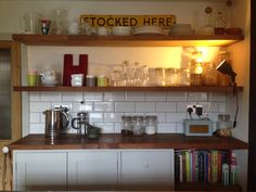 Open shelves, vintage sign and type, metro tiles