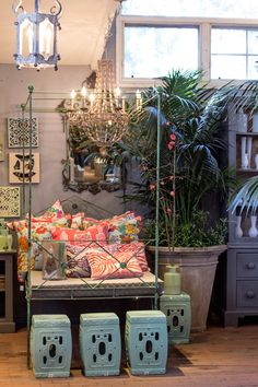 Luscious colors and patterned pillows and prints.   http://rogersgardens.com/home-decor/