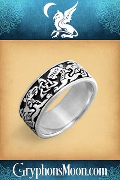 Silver Celtic Dragons Ring - Here is a ring that was meant to grace the hands of kings and heroes. The celtic dragons that are the heart of this wide silver band gaze fiercely at each other over the triquetra knot at the center. The Silver Celtic Dragons Ring captures the spirit of a time long past, where it would have looked at home in torchlit halls or fierce battlefields. #Dragon #CelticDragon #DragonRing #CelticDragonRing #WeddingRing #SilverRing #CelticKnot #CelticKnotwork #CelticJewelry Celtic Rings, Celtic Knot, Puzzle Ring, Dragon Ring, Celtic Dragon, Great Father's Day Gifts, Engagement Sets, Ring Stand, Triquetra