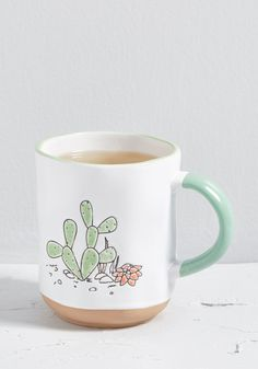 This white mug from One Hundred 80 Degrees is such an adorable addition to your vessel collection. Detailed with a dimpled exterior, a cactus motif, and. The Grinch, Cute Coffee Mugs, Coffee Cups, Funny Coffee, Coffee Coffee, Disney Dumbo, Pantone, To Go Becher, Glass Tea Cups