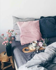 Breakfast in bed looks even better with pink, blue and grey decor. More