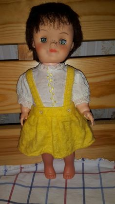 Vintage 1960s frecles doll. I think she is very cute.