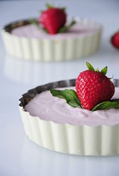 Mini Vegan Strawberry Cheesecakes Recipe that is Gluten free, and Paleo friendly. Rich and Creamy made with coconut cream, mint & strawberries.