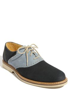 The jaunty style of a classic saddle shoe is updated with a suede and nubuck upper grounded by a durable rubber sole.