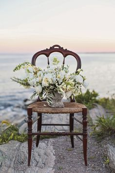 Floral centerpiece for a beach wedding | Amanda Berube Photography | see more on: http://burnettsboards.com/2014/11/whimsical-rocky-coast-wedding-inspiration/