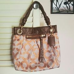 COACH purse-- brown leather with tan fabroc with signature C's all around it!! Beautiful bag!!        $75