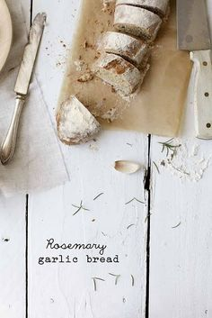 Love the composition and rustic feel of this shot! Rosemary Garlic Bread