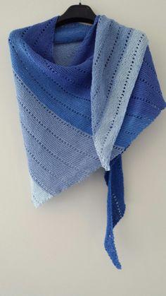 Blue triangular shawl.