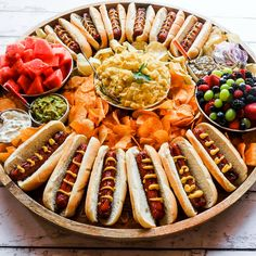 Epic Hot Dog Board for summer hosting with delicious polish sausage hot dogs. Great for Father's Day and Fourth of July! Party Food Platters, Food Trays, Party Trays, Charcuterie And Cheese Board, Football Food, Food Presentation, Appetizer Recipes, Appetizers, Hot Dogs