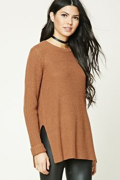 A midweight knit sweater featuring a boxy silhouette, crew neckline, long cuffed sleeves, and a vented hem.