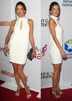 Alessandra Ambrosio wearing a white sleeveless, high-neckline keyhole mini dress from the Camilla and Marc Spring 2014 collection