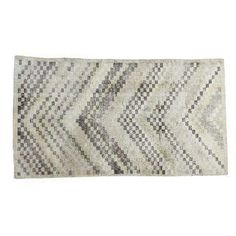 A Modern style, vintage Oushak rug with a checker motif. Circa 1960's Turkey, this rug has a distressed aesthetic with lovely texture and worn appearance. Great neutral shades of ivory, charcoal, super soft faded coral rose and moss greens. Many years of enjoyment to come with this rug! Recently professionally cleaned, ready for in-home use.