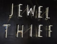 'Jewel Thief' Neon sign. it could have been made for Angel by Tracy Emin