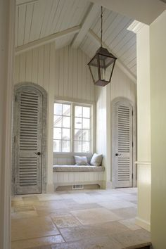 Mike Hammersmith, Inc. - Atlanta Custom Builder great closet doors and window seat...love the plank wood paneling!