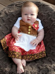 Ms. E wearing her 3-6 month dirndl with pride.