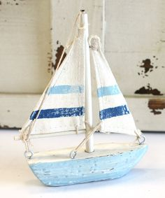 Small blue and white wood sailboat with canvas sail measures x and makes a great accent piece or nautical party favor! Beach Cottage Style, Beach Cottage Decor, Coastal Cottage, Coastal Style, Coastal Decor, Nautical Party Favors, Deco Marine, Small Sailboats, Interior Design Advice