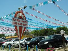 How do you find a used car dealer? You have only to follow balloons, Hula flags, flags and inflatables. www.carpoos.com