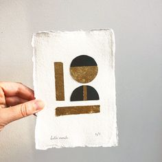 A little experimental collage using hand cut card, gold leaf, and hand made paper.  I love simple shapes and textures, and the contrast of the gold against black.