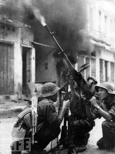Viet Cong soldiers firing an anti-aircraft gun, South Vietnam, 1969. - Vietnam War