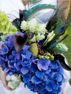 Flowers: Posts tagged Flowers on Art Deco Weddings. flowers, art deco flowers and roaring twenties bouquets for a themed wedding or event. Everything from vintage photos to modern style guides to help you find the perfect vintage flower arrangements. Peacock Theme, Peacock Wedding, Perfect Wedding, Our Wedding, Dream Wedding, Wedding Stuff, Wedding Photos, Wedding Bouquets, Wedding Flowers