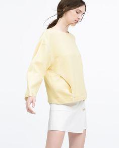 Image 2 de TOP POCHES LISERÉS CONTRASTANTS de Zara