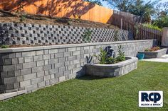 Retaining wall block including planters.
