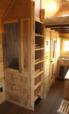 """I like the built-in storage with bookshelves facing inward, """"camouflaging"""" the ladder. I know this is for an actual house but I wonder if I could incorporate this into my skooli re-do?"""