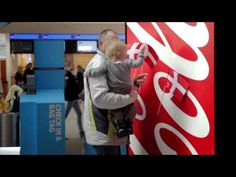 Welcome to The Happiest Country in the World -- a creative promotion by Coca-Cola at the Copenhagen Airport.
