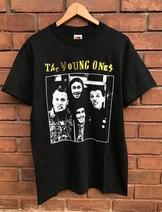 Vintage Deadstock The Young Ones 1982 British Sitcom Comedy TV Series / Rik Mayall Alternative Comedy / Punk T Shirt British Sitcoms, British Comedy, Comedy Tv Series, Rik Mayall, European Tour, Young Ones, Vintage Tees, Alternative, Trending Outfits