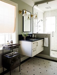 Hexagonal floor tiles befitting a Federal-style home are juxtaposed with a modern floating vanity. Traditional Bathroom, Traditional House, Modern Traditional, Interior Design Kitchen, Interior Decorating, Decorating Ideas, Federal Style House, Lauren Liess, Floating Vanity