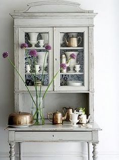 Painted hutch. Beautiful...you can get this look with Chalk Paint™ in Paris Grey, with Clear then Dark Soft Wax™...Annie Sloan, of course.