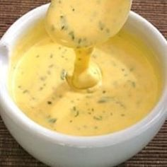 This deliciously creamy herb sauce is so simple to make using a microwave, but if you do not have one, place your bowl over a pan of simmering water to heat it gently. Excellent German recipe for Bernaise sauce. Great on steaks, chicken, vegetables and fish.