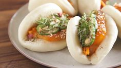 Steamed buns: pockets of steamy goodness, just waiting for you to fill them with tender meats, pickled vegetables, fresh herbs, and ooey-gooey sauces. While the Chinese have been making mantou—steamed bread dough—forever, America's obsession with the buns can be credited to David Chang.