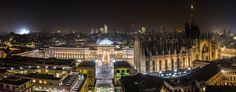 Nightlights of Piazza del Duomo with skyscrapers looming beyond the Galleria Vittorio Emanuele II and the Duomo di Milano Milan Lombardy Italy [2048801]