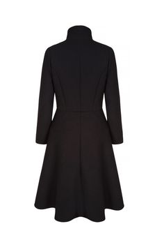 Beautiful wool crepe special coat inspired by a vintage hunting coat. Tailored bodice with high back neck pitch. A flattering fluid circular skirt part falls below the knee at the front. The hemline sweeps up to down from front to back. Concealed button placket at the centre front. Optional closure to completely fasten at the neck or leave undone to its natural break at above the chest point. Immaculately presented. A flattering silhouette which is a dream to wear. x