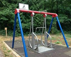 A swing made for wheelchairs on a playground <3