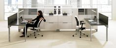 Teknion District System. Storage spine defines space, provides ample storage. The minimal desks add a light counterpoint to the visual weight of the storage.