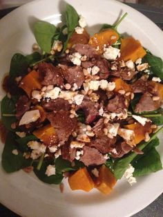 *Balsamic Lamb, Pumpkin, Pine Nut & Baby Spinach Salad PREP TIME 15 mins + marinating time SERVES 4 adults Ingredients 600g lamb backstraps 2 tablespoons olive oil 1 large clove garlic, crushed 1 sprig rosemary, roughly chopped Rock Salt & freshly ground black pepper 400g pumpkin, peeled & thinly sliced 200g Baby Spinach 50g feta cheese, crumbled 2 tablespoons pine nuts, lightly toasted Dressing 2 tablespoons balsamic vinegar 1/3 cup extra virgin olive oil
