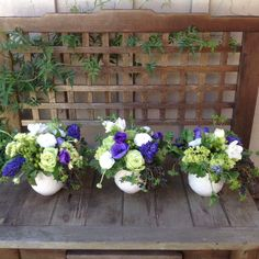 Spring flowers in blues and green and white by Fleur de Vie.