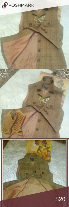 """🍍🍍Harolds tweed vest🍍🍍 Beautiful, classic vest. Reminds me of Kentucky horse ranch's. Tight camel pants, turtleneck, this vest w riding boots=flawless. 5 button closure, 2 faux front breast poskets, belts.  Vest is Camel with brown and tan running thru it. 🍍length 25"""" 🍍chest laying flat front measurement 18"""" Attention. 2 minor flaws. 1) tiny hole in belt as seen in photo. 2) left side thin piece that belt loops in is missing. It's not a major piece of fabric or part of the vest.  It is…"""