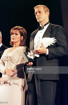 Marie Osmond and actor John Schneider on stage after they were presented 'The Service to America Samaritan Award' during the 2000 Service to America Awards presentation ceremony June 12, 2000 in Washington.