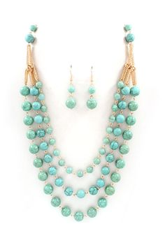 Notice the unique way the 3 strands are reduced to one--Polished Turquoise Beads chicly suspended from Golden Layers. Earrings Included. NECKLACE LENGTH: 26 inches + Extender NECKLACE CLOSURE: Lobster claw clasp